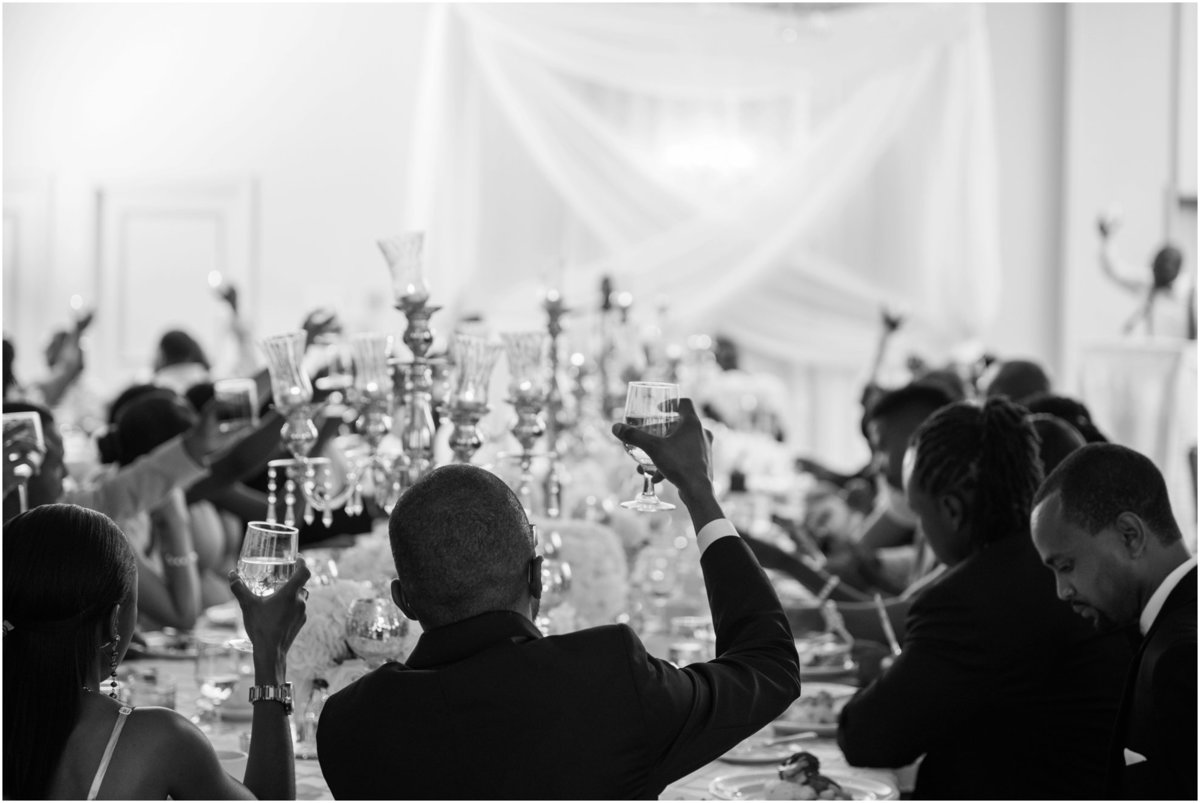 Guests toasting bride and groom at reception