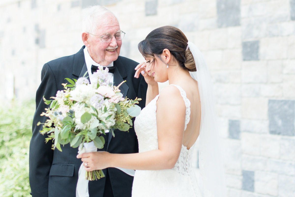 A bride tears up during her first look with her grandpa