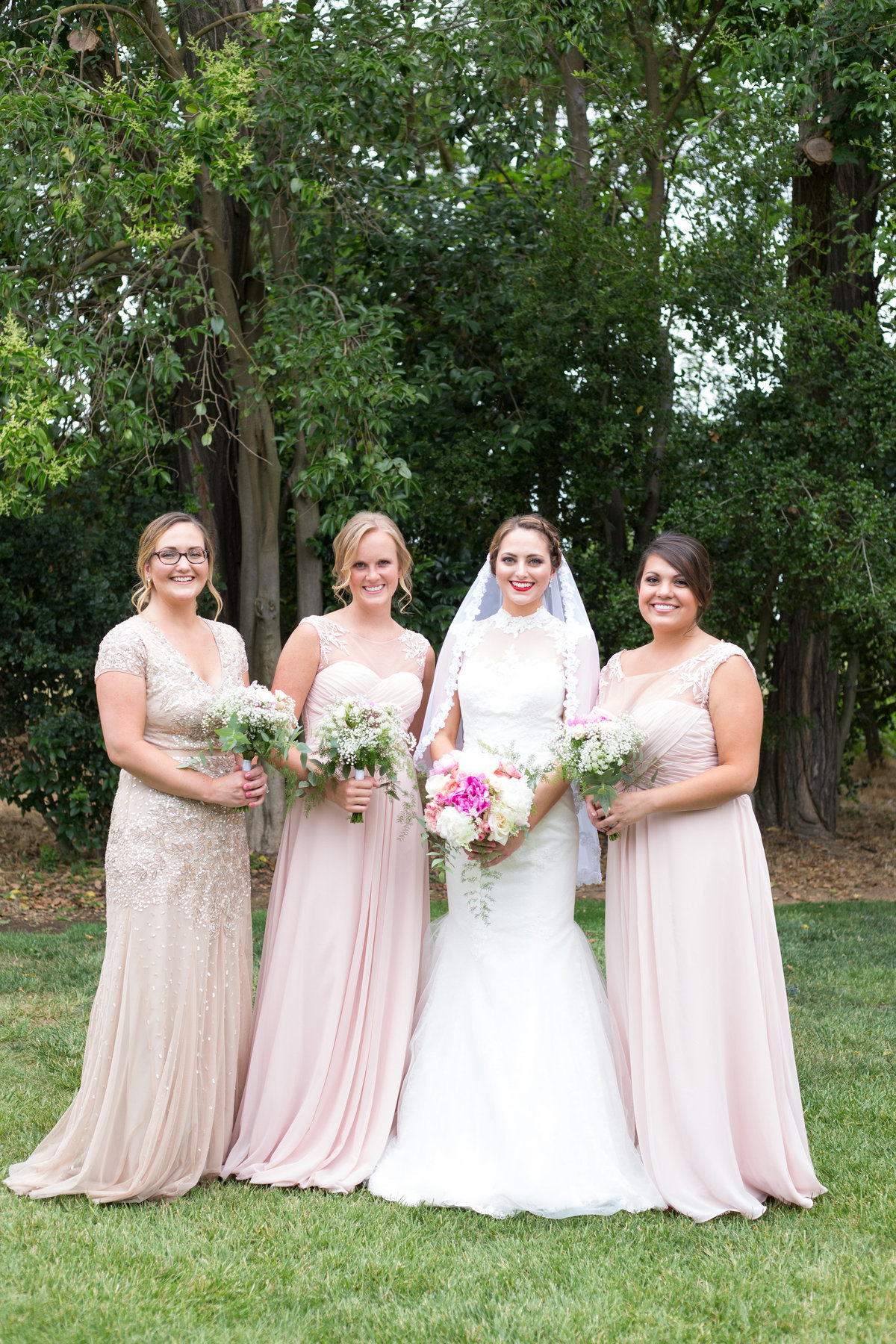 bridesmaids pose for group photo at wedding in northern california
