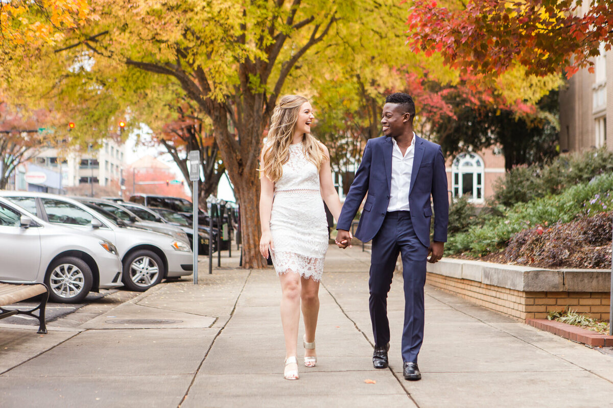 interracial couple eloping at the courthouse in downtown athens in the fall