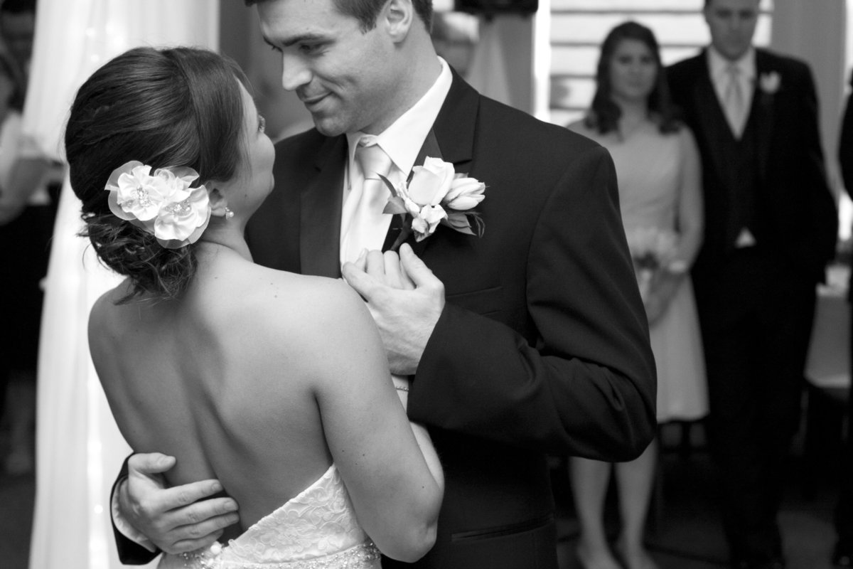 romantic black and white of bride and grooms first dance