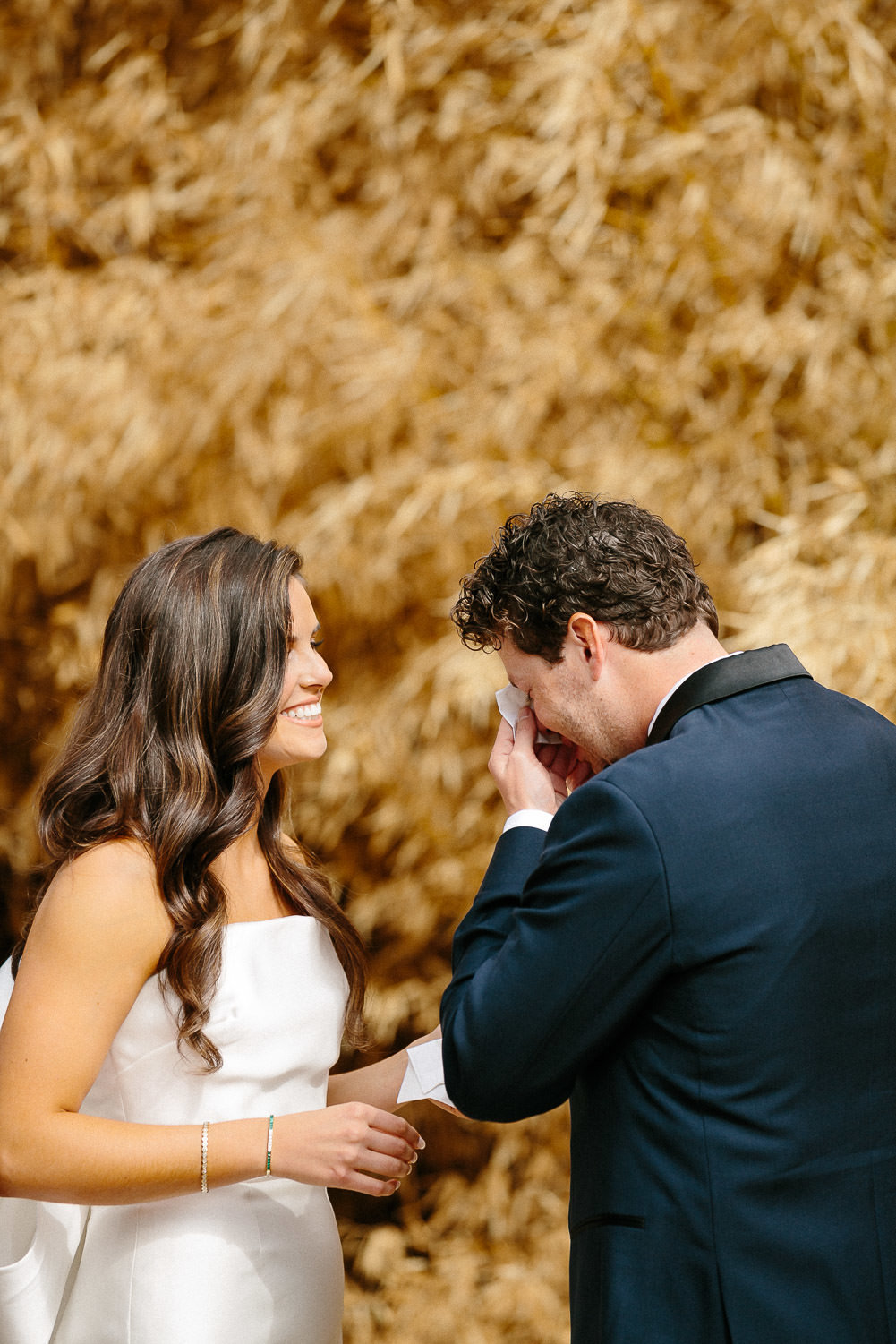 bride and groom seeing each other first time wedding look reaction in front of golden plants Austin