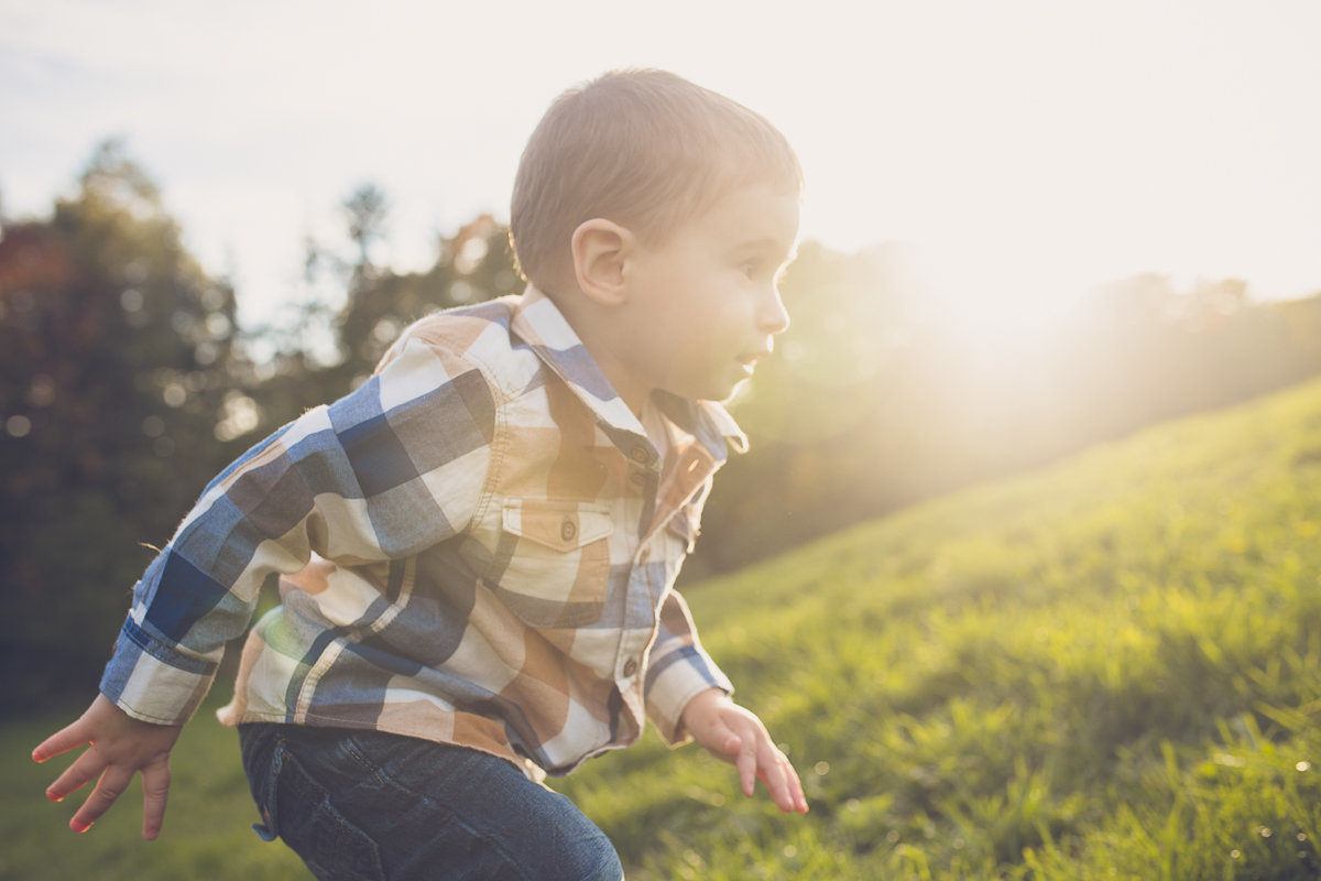 Toddler boy running up hill outdoors {Milton Child Photographer}