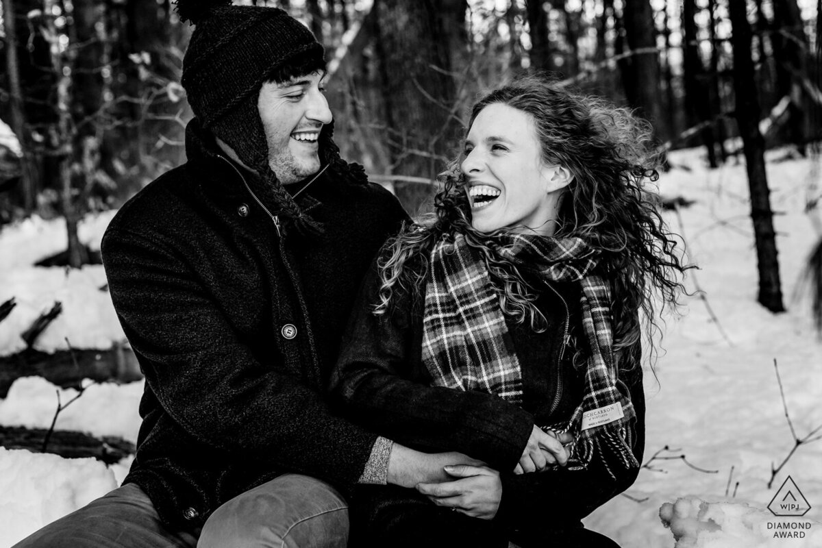 The Fells Reserve in the winter hosts the couple who play in the snow for their engagement session