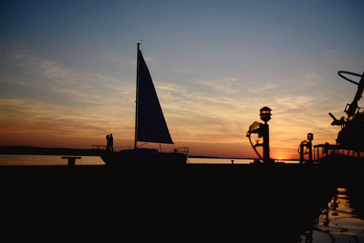 sunset silhouette at sailboat engagement session