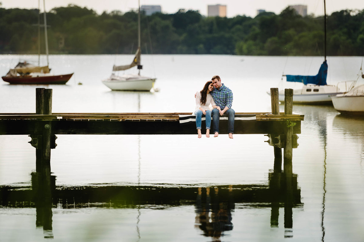 couple sitting at white rock lake during their dallas engagement session