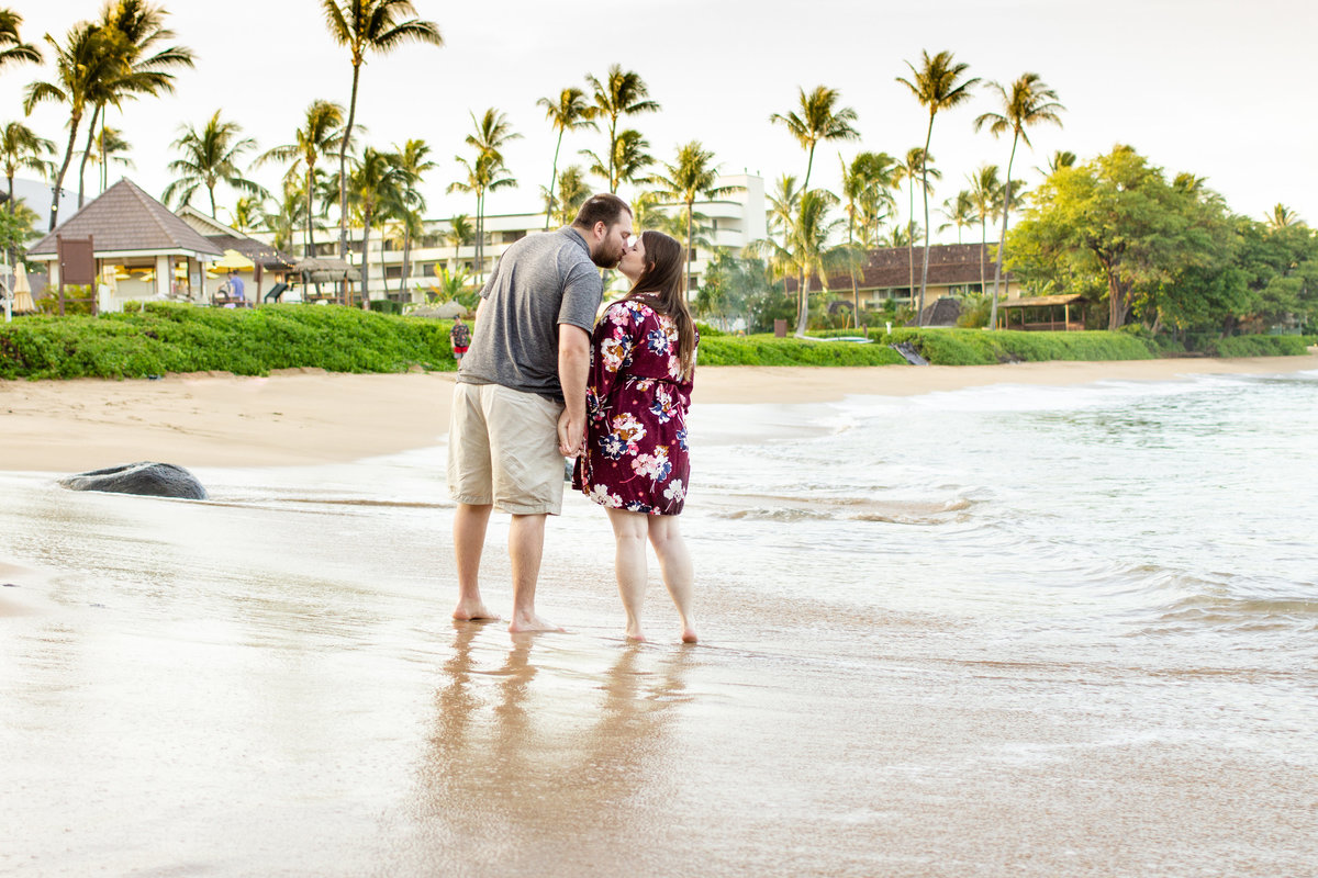 Destination engagement session for couple on Maui, Hawaii at sunrise on Black Rock Beach