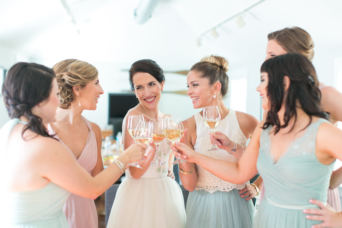 Bridesmaids cheersing - Annapolis Maritime museum wedding photos