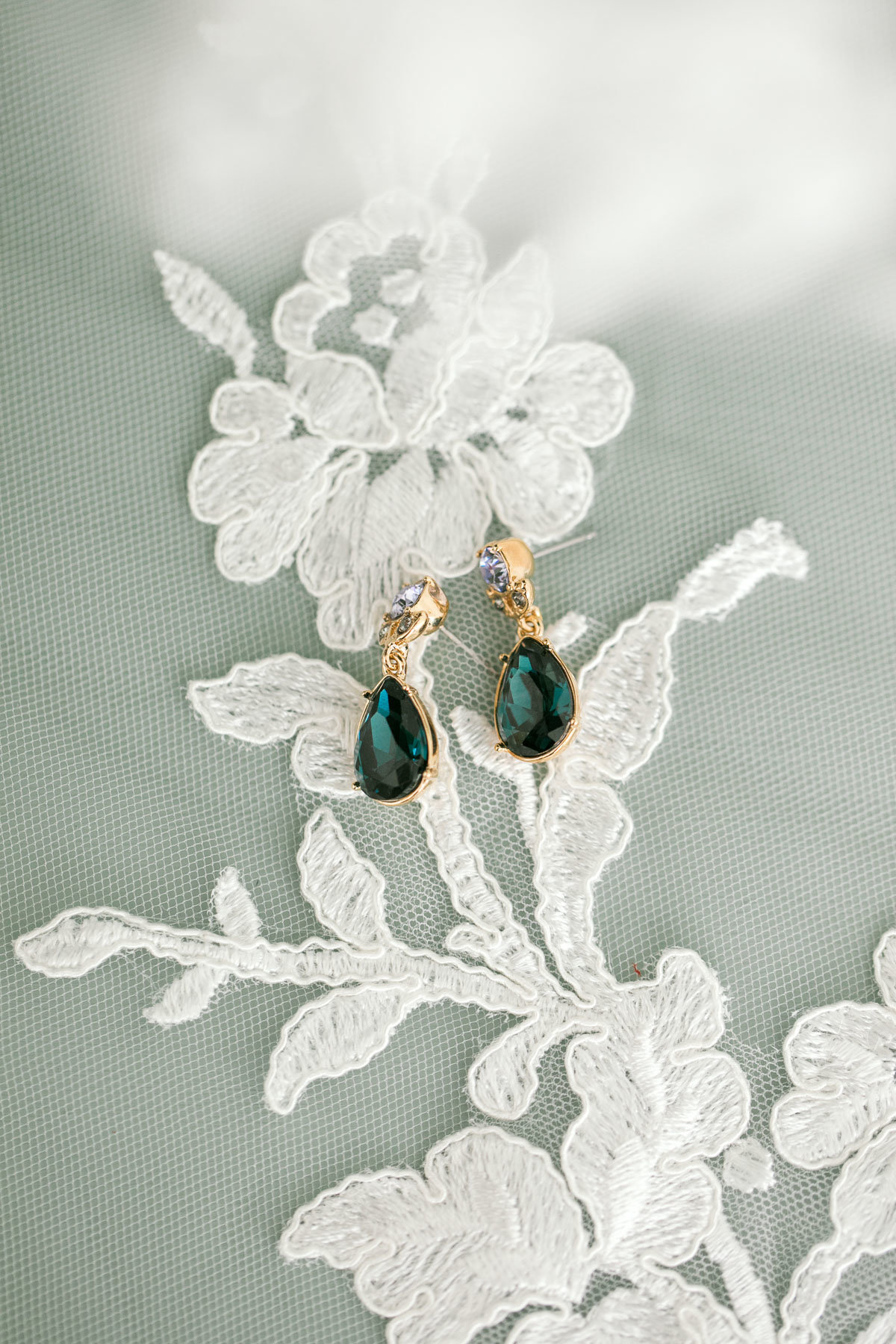 vintage emerald green earrings on lace