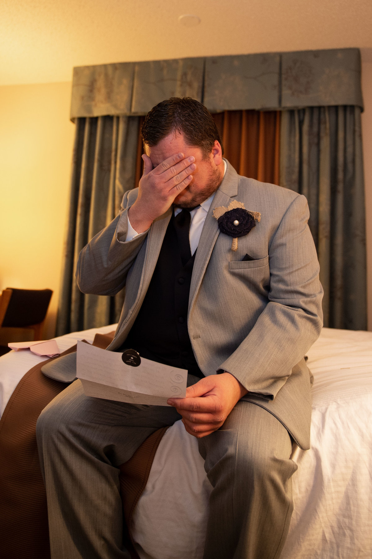 groom reads letter from bride before ceremony