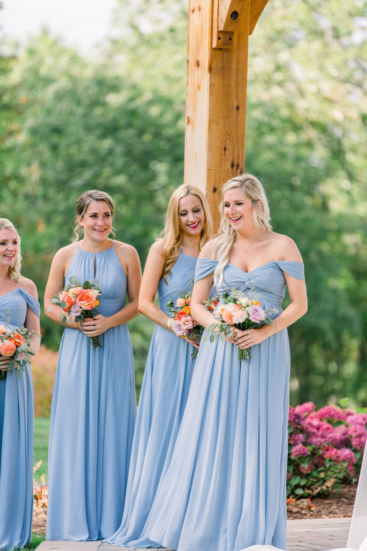 Fine Art Michigan Wedding Photographer captures bridesmaid laughing during Northern Michigan wedding