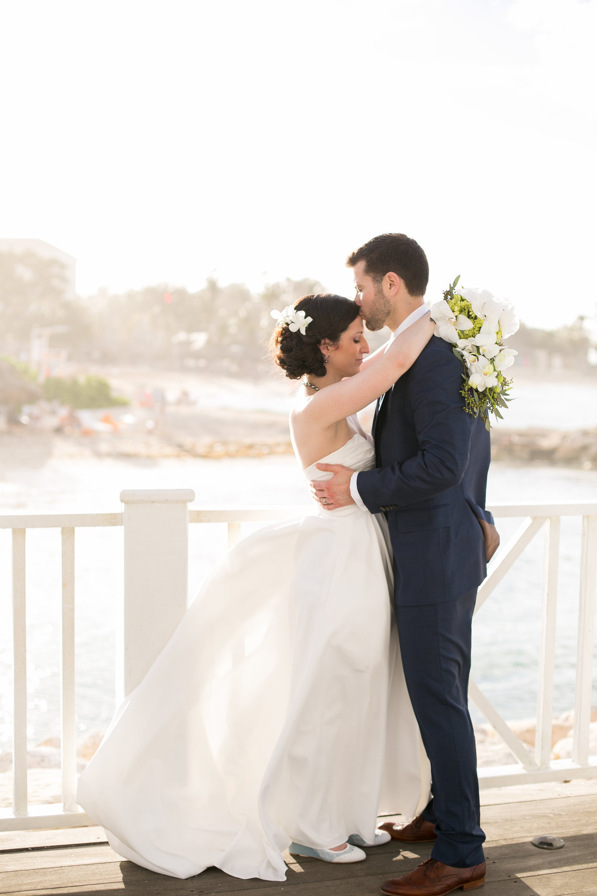 Bride and groom standing on a pier for their Jamaica Destination Wedding