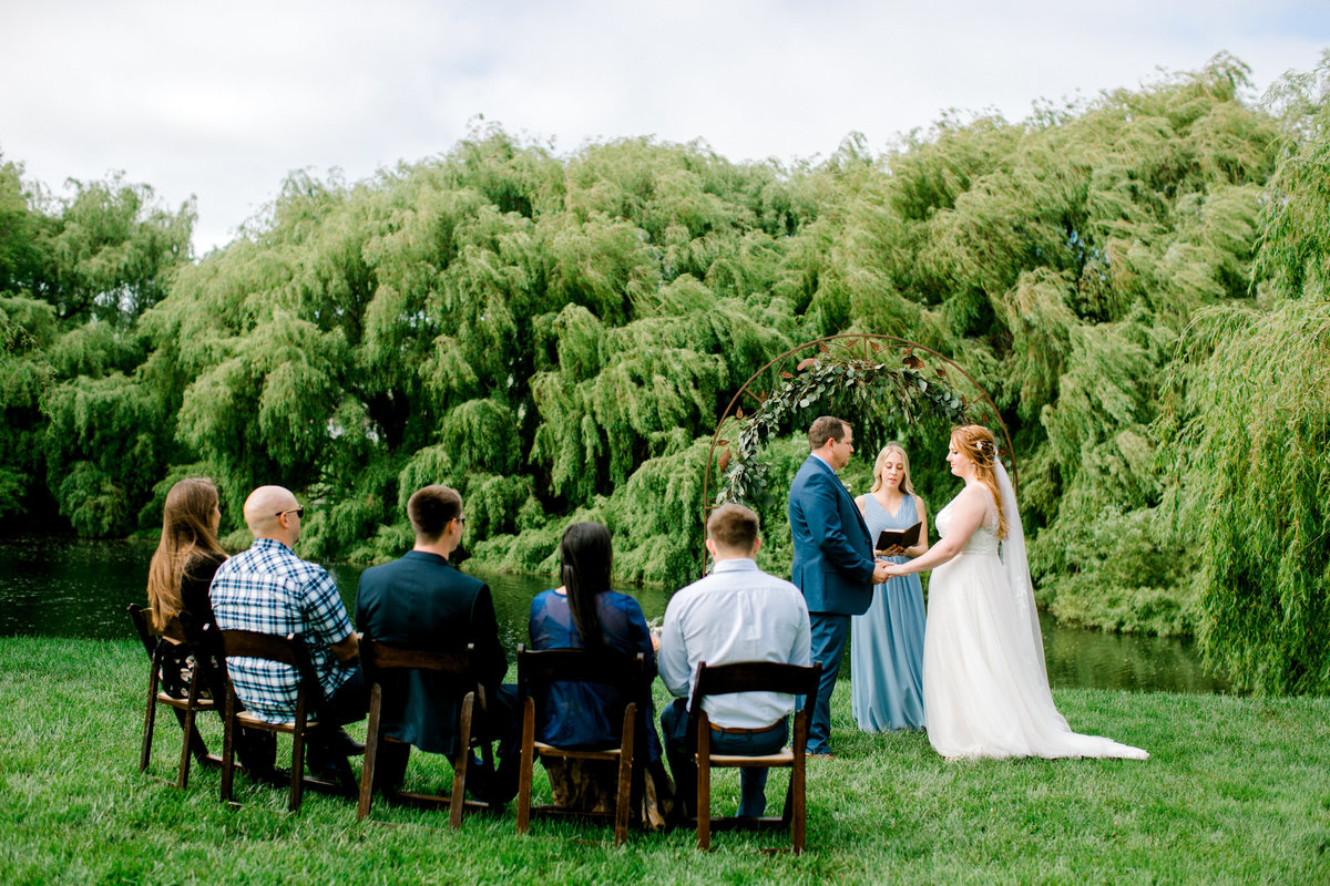 Wide view with guests during ceremony at Olympias Valley Estate in Petaluma California
