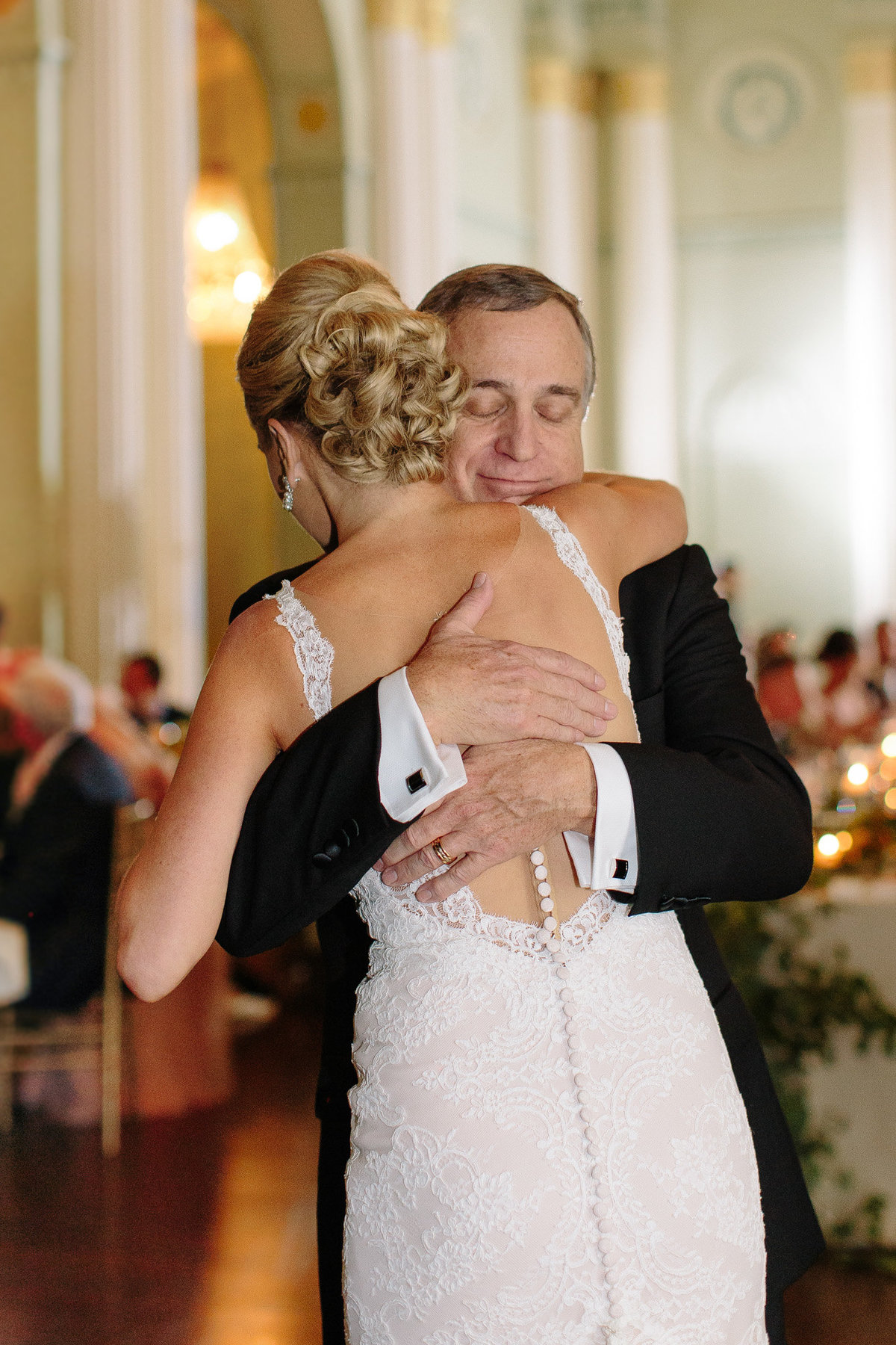 An emotional real moment during the father daughter dance.  Photo by top Atlanta wedding photographer Rebecca Cerasani.