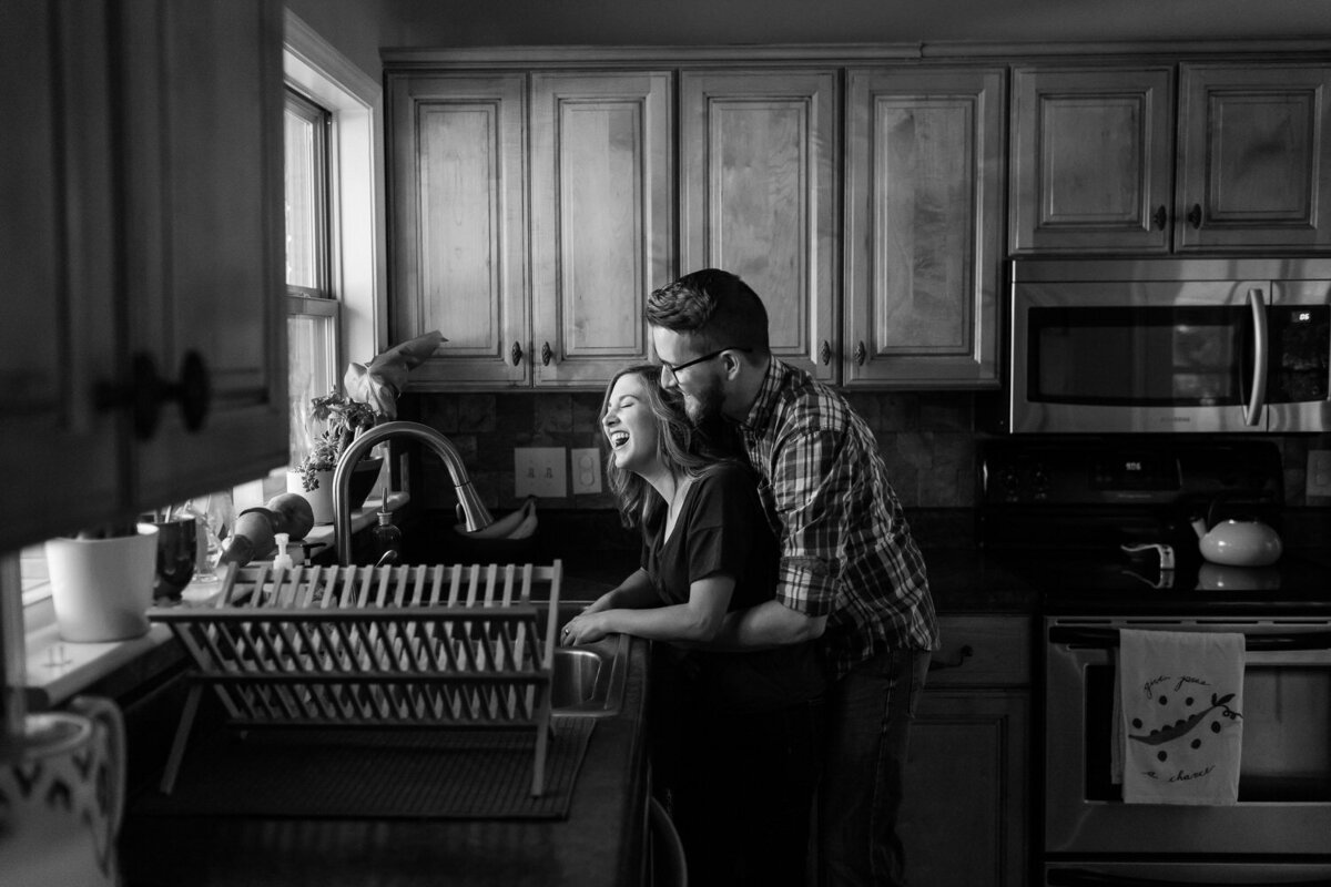 couple washing the dishes in a kitchen in lifestyle in-home shoot