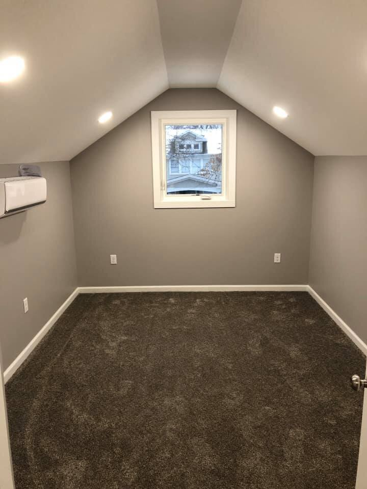 Room with grey walls and carpeting