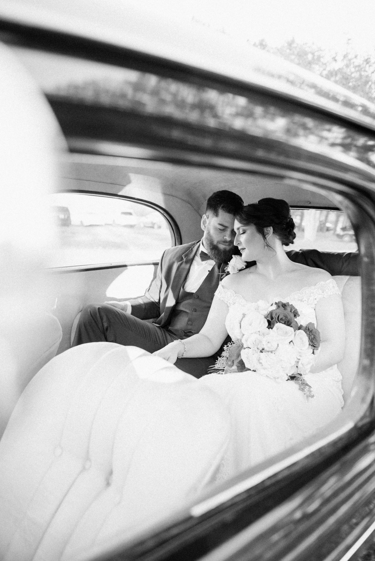 Bride and groom in antique car at Woodlawn Maryland wedding