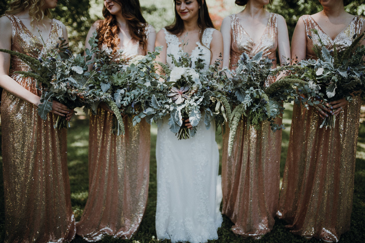 Bride and her bridesmaids with gold sequin bridesmaids dresses at this beautiful Adams Estate wedding