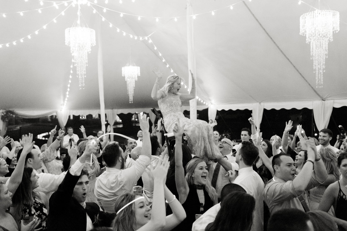 tent wedding with hanging chandeliers
