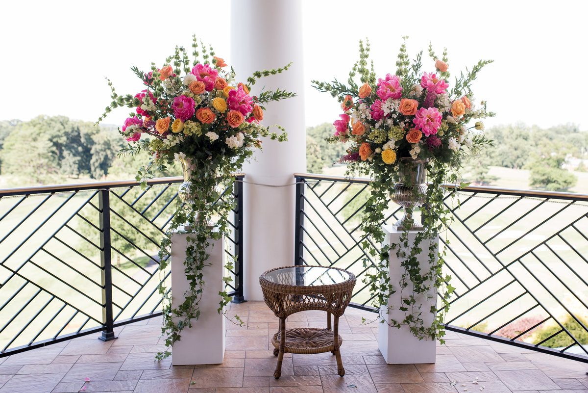 Wedding alter with tall arrangements  on pillars