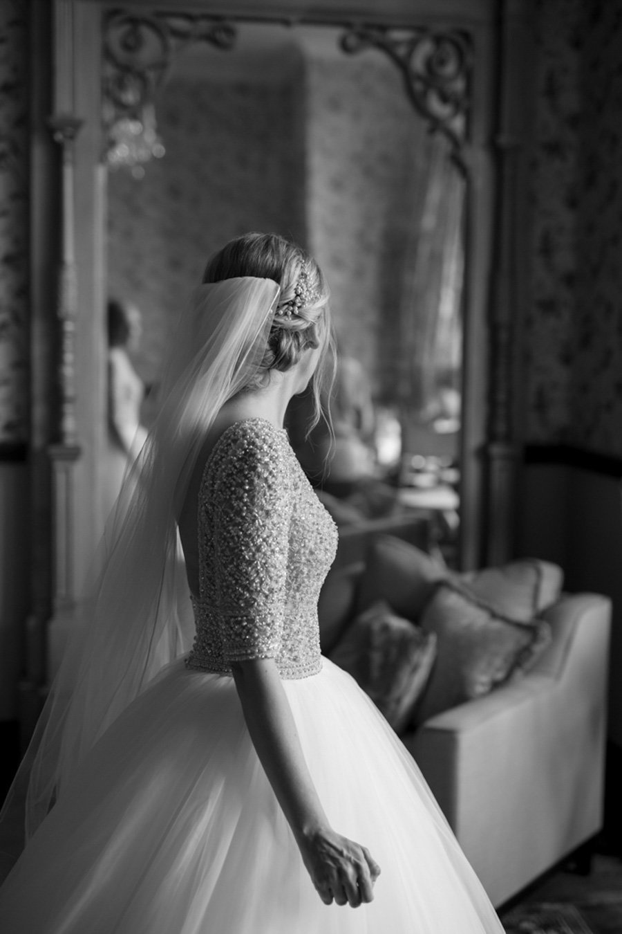 Black and white of Bride getting ready at Huntsham Court Devon