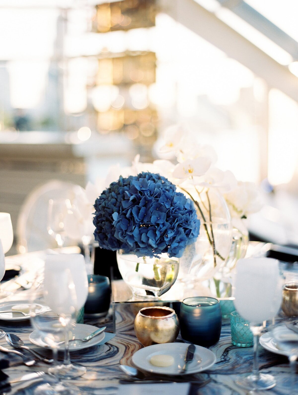 Blue and white hydrangeas in wedding centerpiece