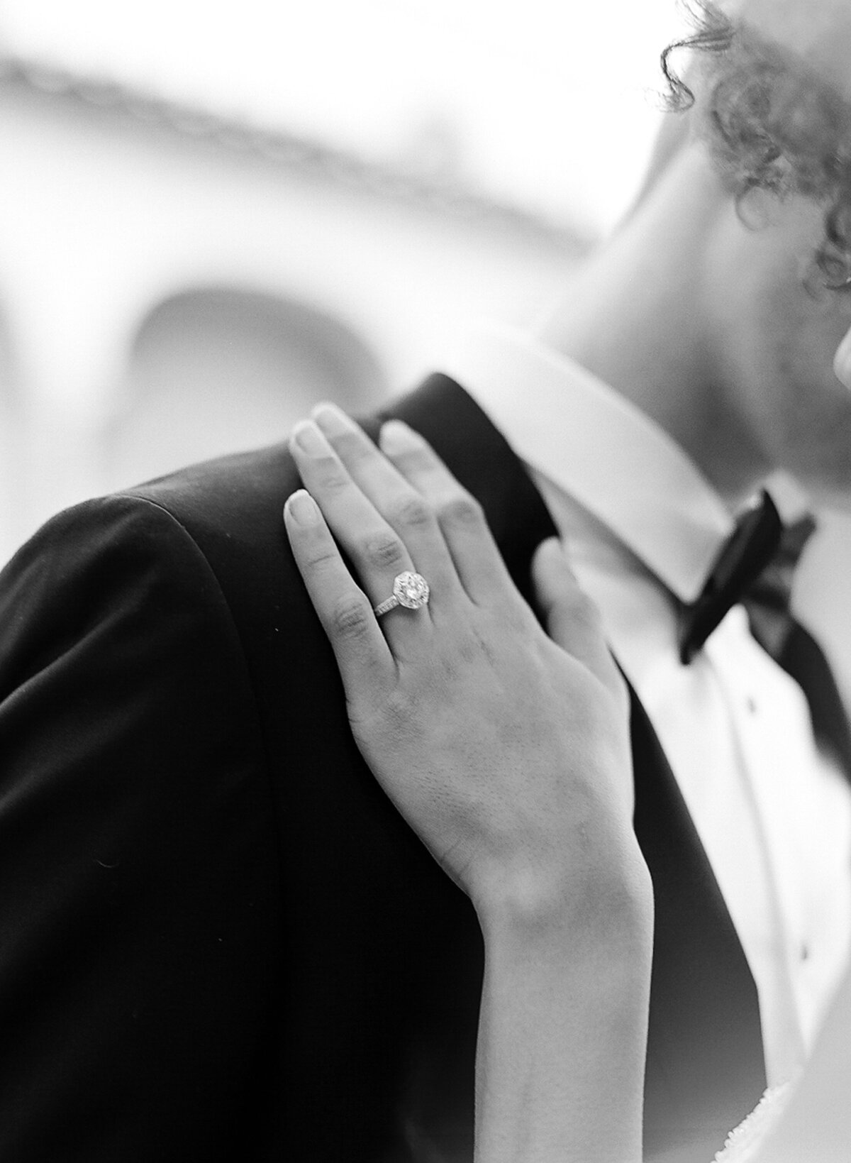 Black and white photo of bride's engagement ring