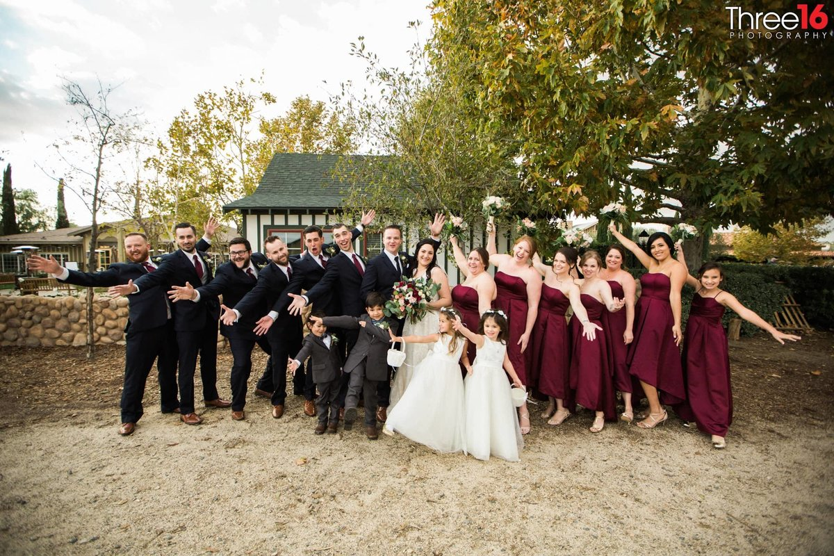 They Did It! Bride and Groom pose with their wedding party