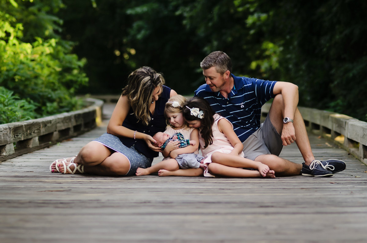 Portrait of a family of five on a wooden path taken at a country club in Northern Virginia by Sarah Alice Photography
