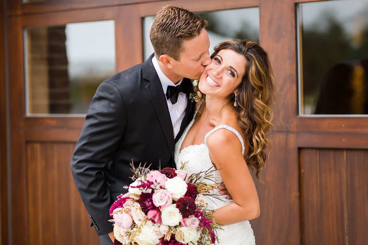 Bride and Groom kissing at Sunny Hill Golf Course - Wedding photographer akron ohio