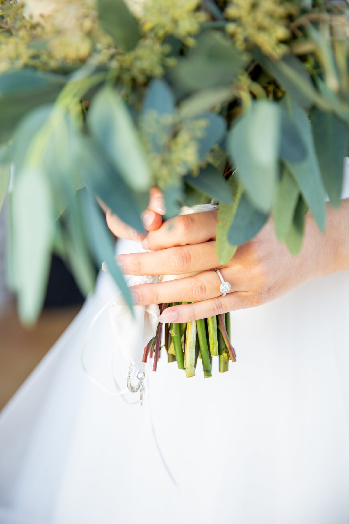 Close Up of Bride's Wedding Ring Holding Her Bouquet