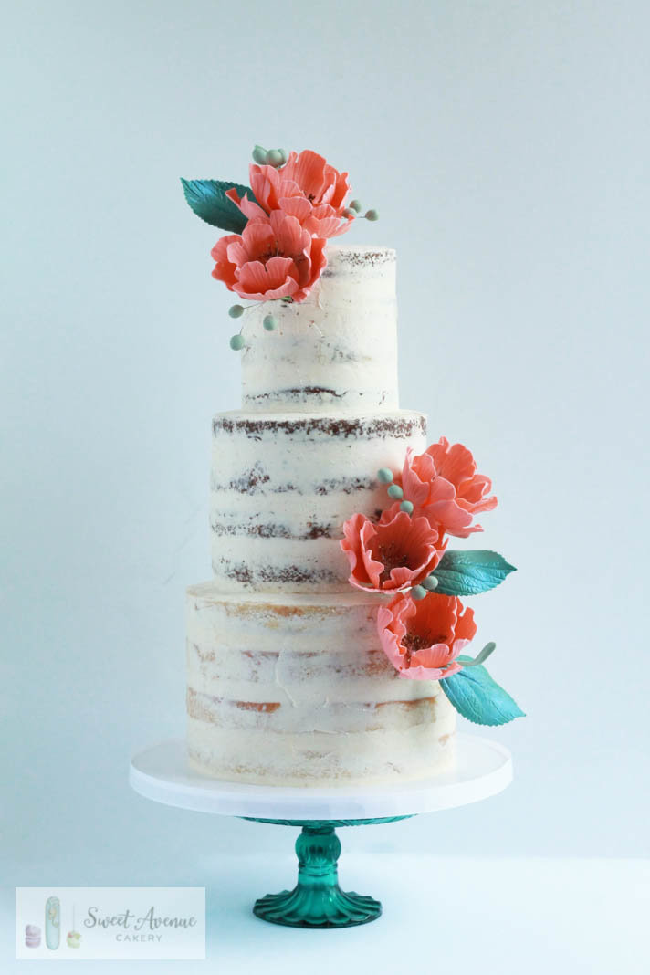 rustic semi naked buttercream wedding cake with peach sugar flowers