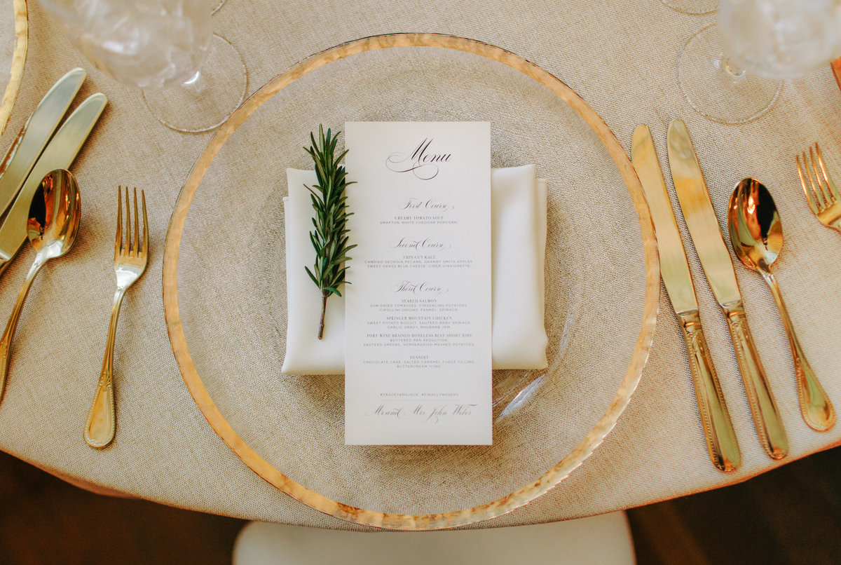 Gold place setting ideas by destination wedding photographer Rebecca Cerasani.