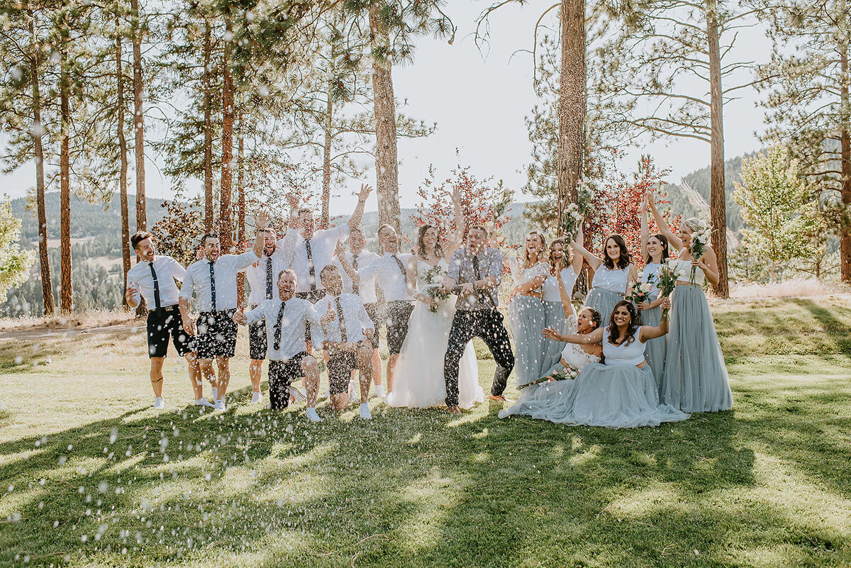 Bridal party popping champagne at a backyard wedding on the Sunshine Coast B.C