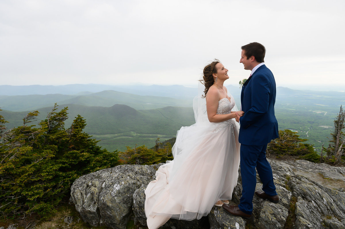 bride and groom on top of the mountain at Jay Peak Elevation 4000 on their wedding day in Vermont8