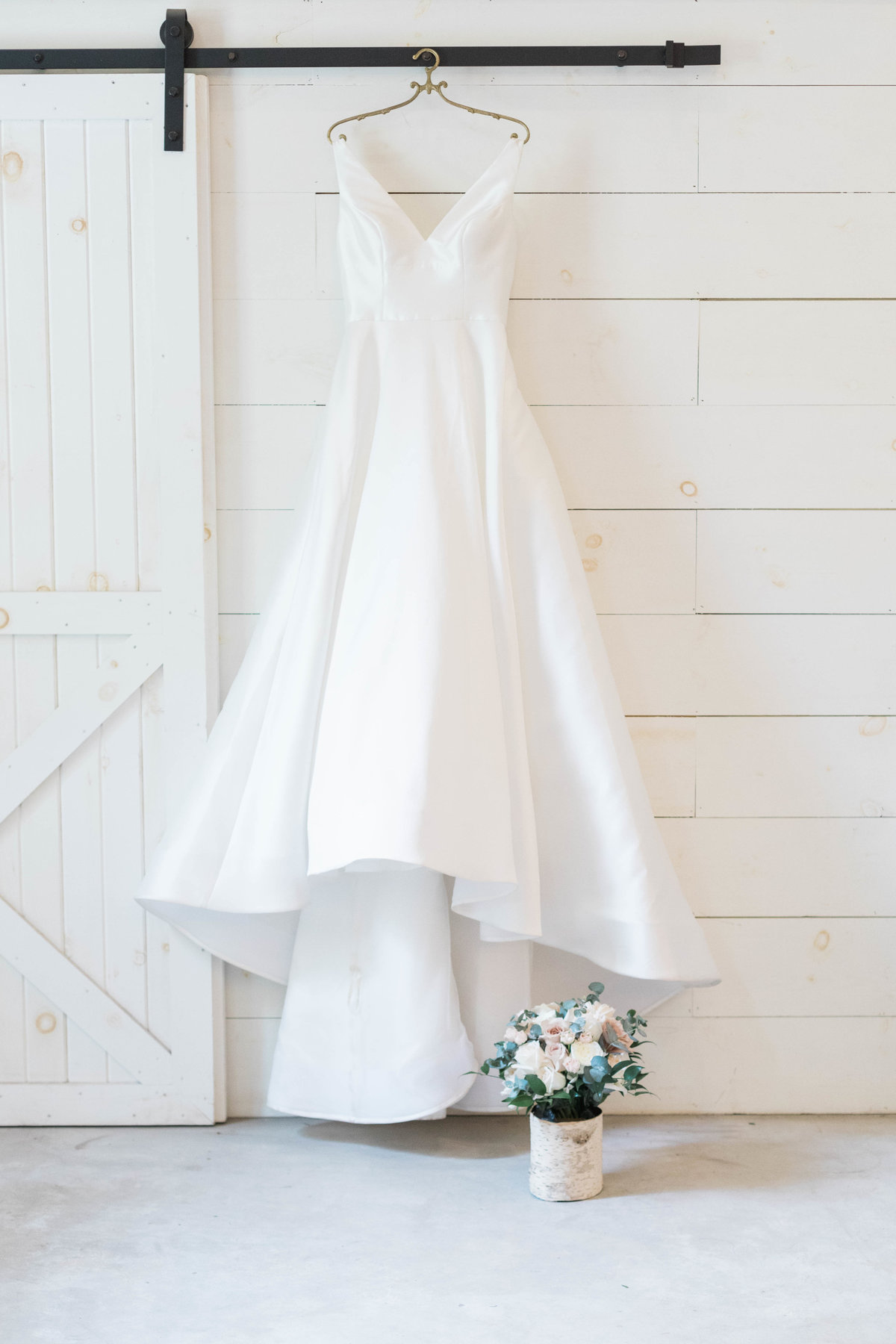 Picture of dress hanging in Chandler Oaks Barn by St Augustine Wedding Photographer