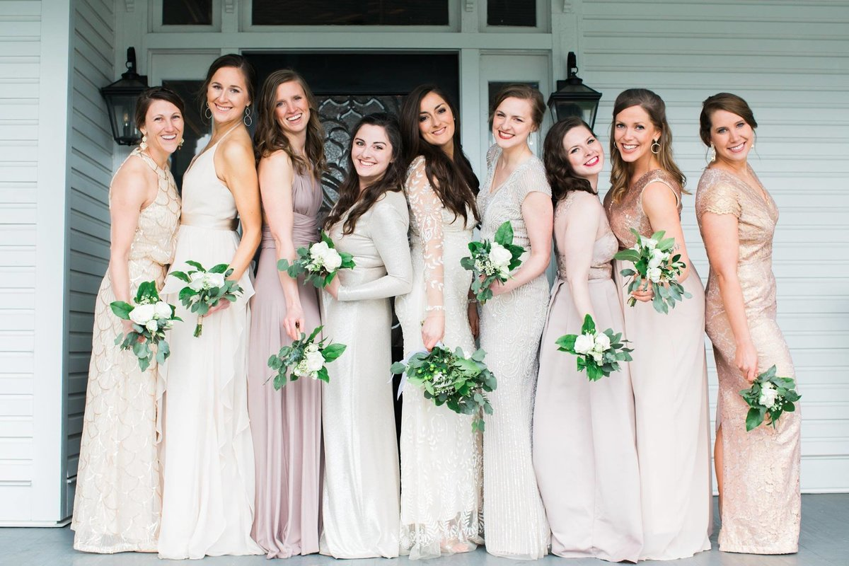 Wedding Photographer, bridesmaids standing together on porch