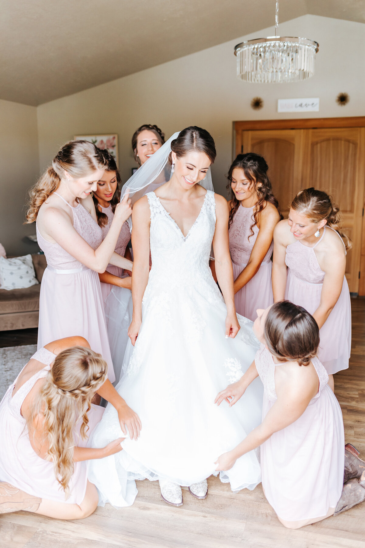 Bride Getting Ready with her Bridesmaids at Still Water Hollow Wedding