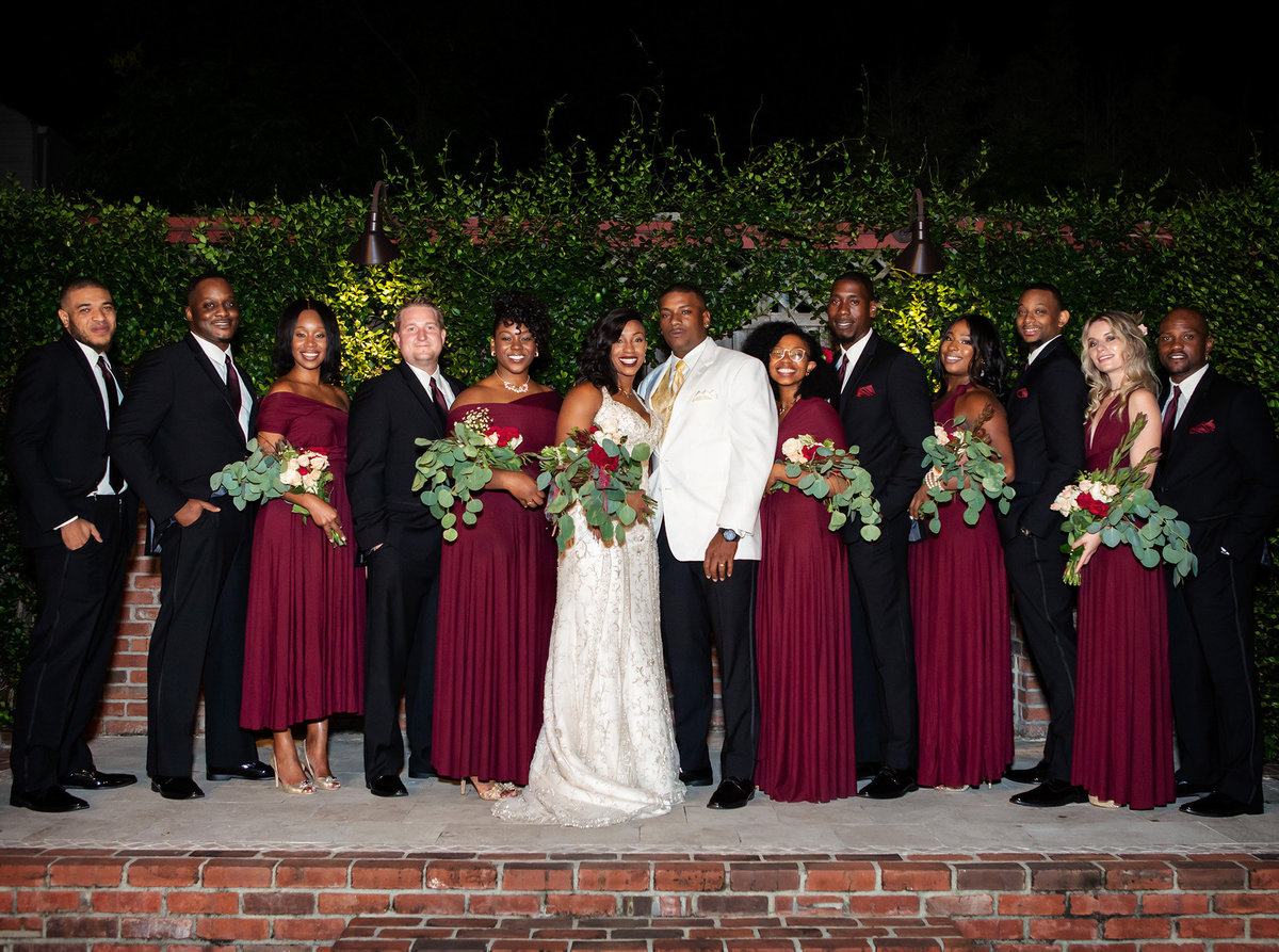 bridal party portrait in the courtyard of Rosy's Jazz Hall
