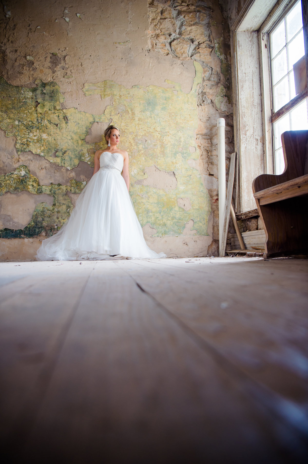 Bridal photo in run down house by Brittany Barclay Photography