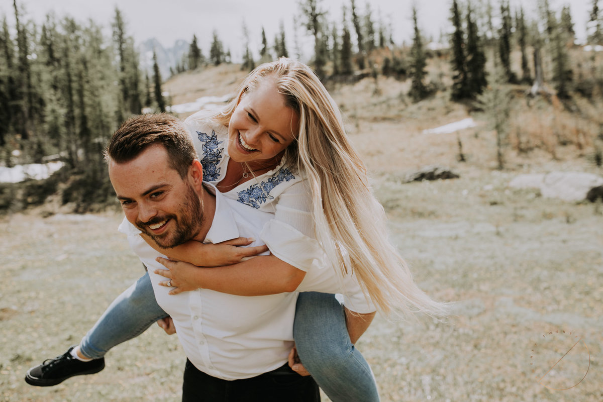 Couple standing in front of helicopter after landing at Marvel Pass by Alpine Helicopters for their heli engagement session captured by Lindsay Copeland of Twenty Twenty Photography
