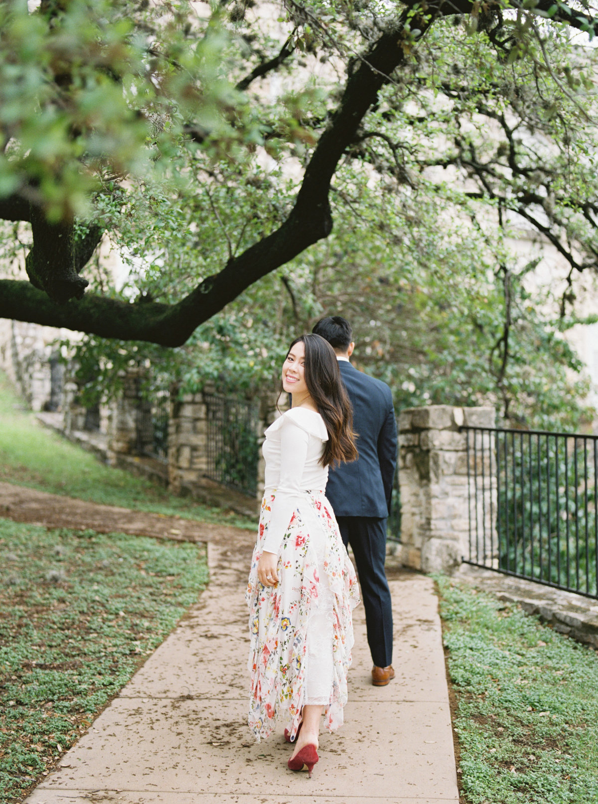 Couple walking down the street holding hands - engagement photos