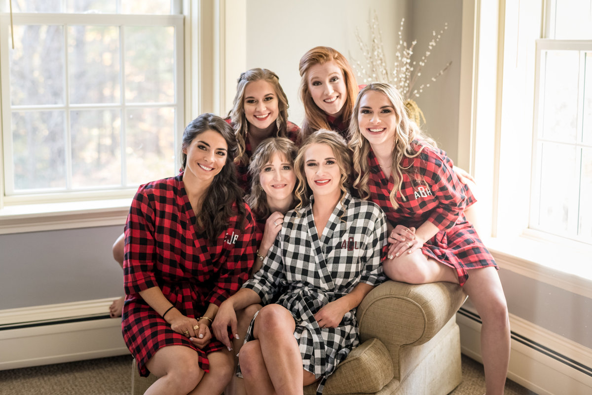 bride and bridesmaids in plaid matching outfits