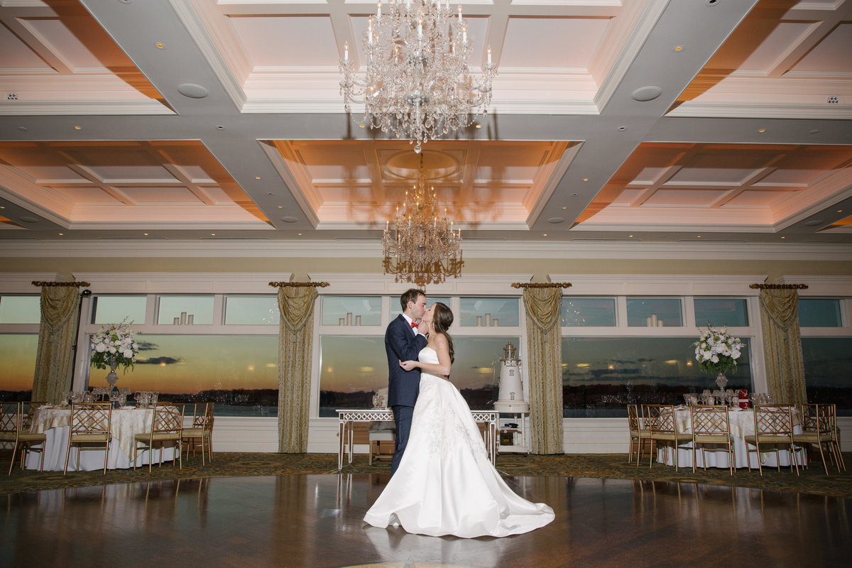 bride and groom in reception ballroom at clarks landing yacht club wedding