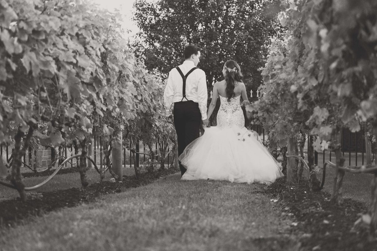 Bride and groom walking the vineyards at Giorgio's Baiting Hollow