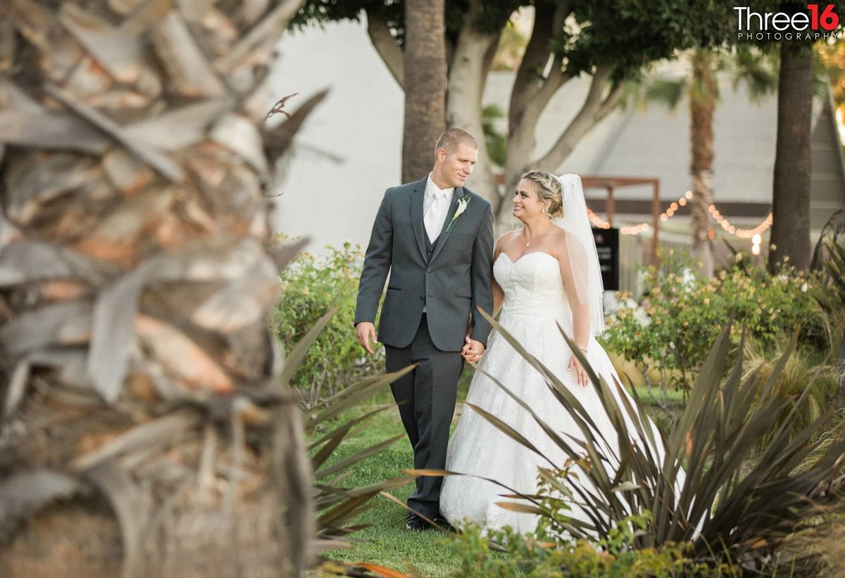 Bride and Groom go for a walk in the beautiful Hotel Maya landscape