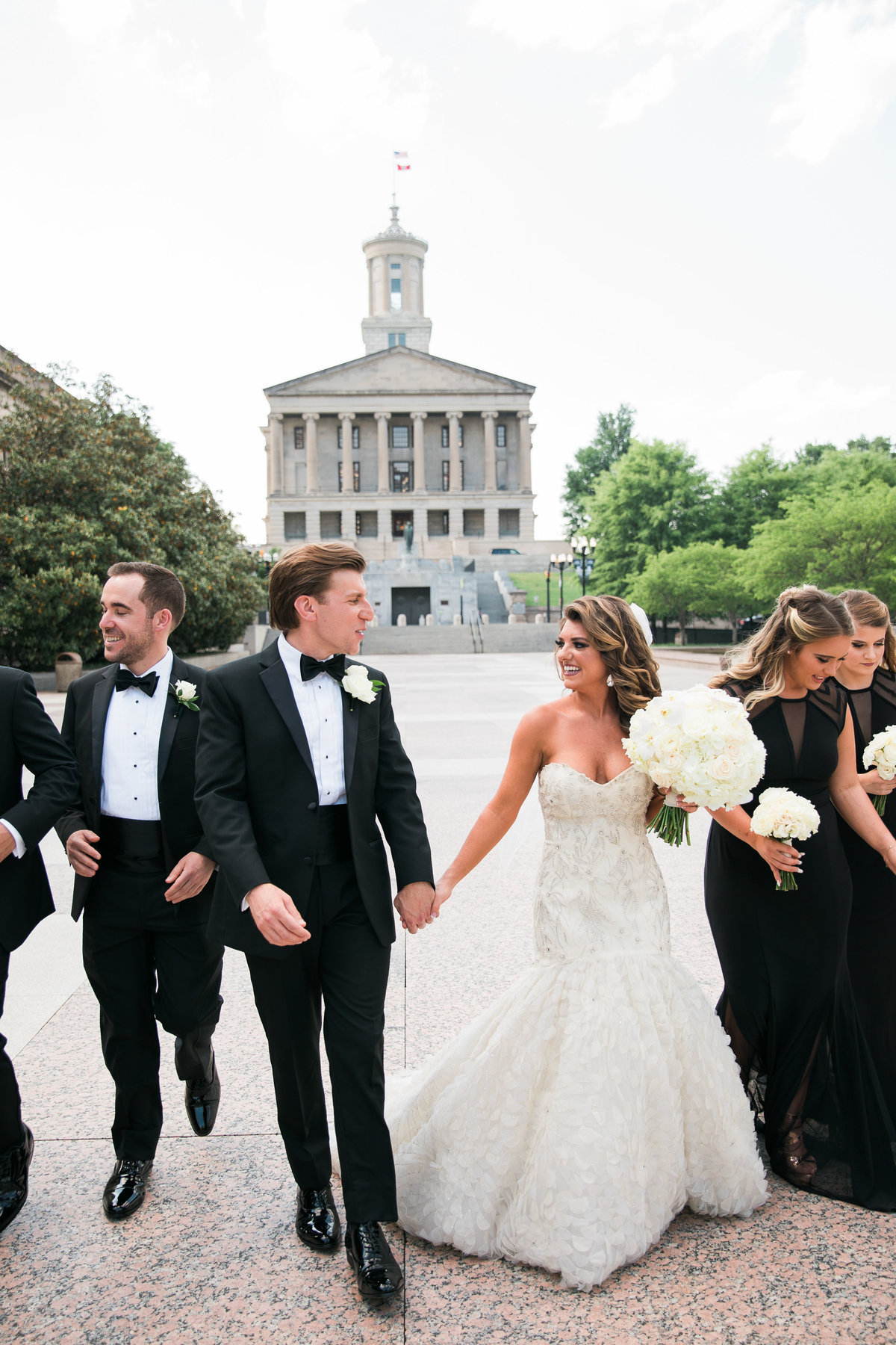 Wedding party with Tennessee capital in the background.