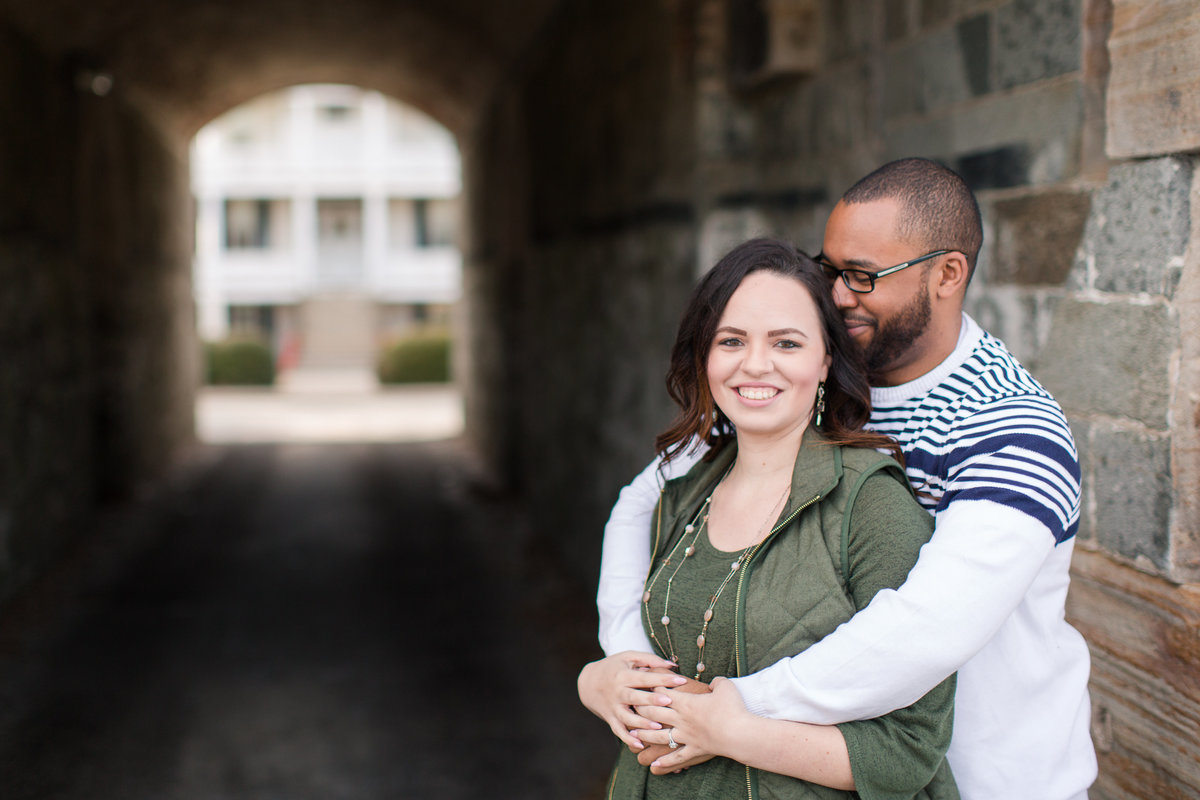 couple hugging at historic fort monroe