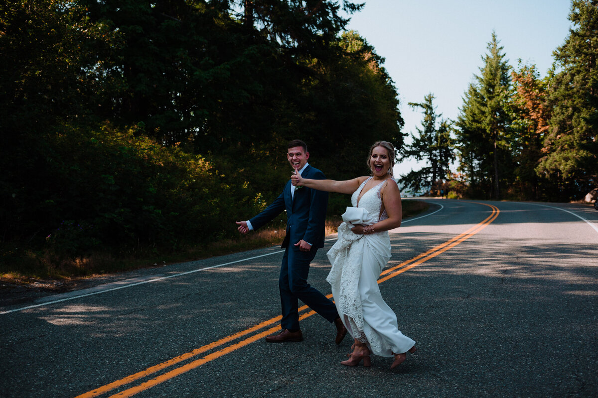 Bride and groom hitch hiking