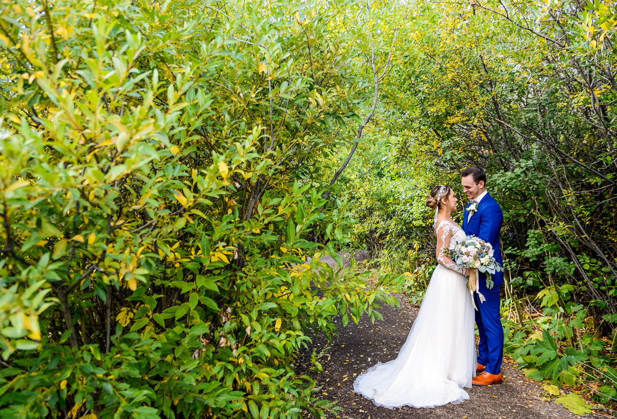 Wedding photographers in Denver - Bride and Groom is forest